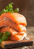 stock photo of redfish  - Raw Salmon Fillet on wooden cooking board - JPG