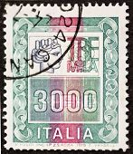 ITALY - CIRCA 1979: a stamp printed in Italy shows Italia Turrita and the indication of an high mone