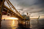 stock photo of construction crane  - oil and rig platform in the sea - JPG