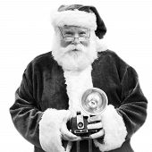 stock photo of saint-nicolas  - An authentic Santa Claus holds an old Vintage camera in black and white - JPG