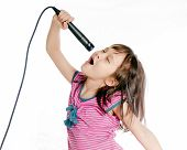 foto of singing  - Asian female child singing with a microphone - JPG