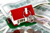 stock photo of chalet  - Family house with money and key - JPG