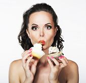 Gluttony. Hungry Funny Young Woman Greedily Eats Cakes With Cream