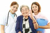 stock photo of politeness  - Smiling Asian medical staff with old woman - JPG