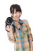 Beautiful smiling asian woman with photo camera. Studio shot on the white background.