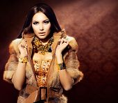 stock photo of vest  - Beauty Fashion Model Girl in Fox Fur Coat - JPG