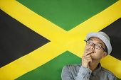 image of jamaican flag  - Thoughtful man against Jamaican flag - JPG