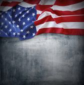 stock photo of democracy  - Closeup of American flag on grey background - JPG