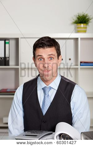 Frustrated Businessman Pulling A Face