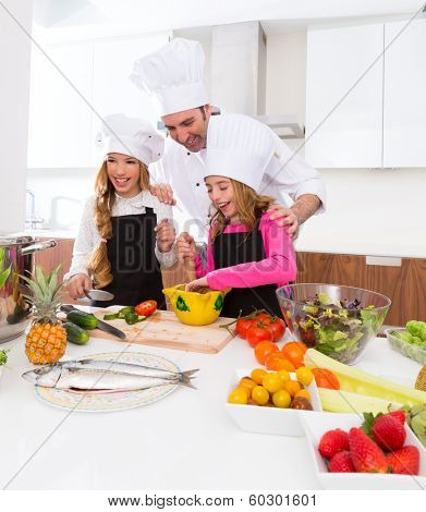 Chef master and junior pupil kid girls at cooking school with food on countertop