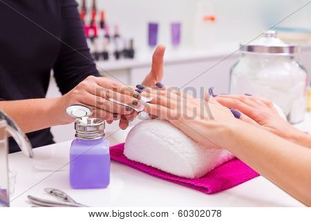 Nails saloon woman nail polish remove with tissue for new manicure