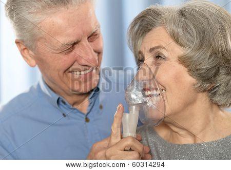 Elderly couple with inhaler