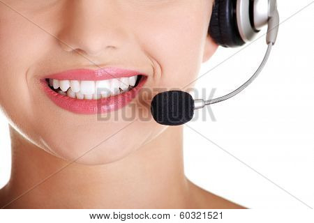Young call-centre assistant smiling at the camera , isolated