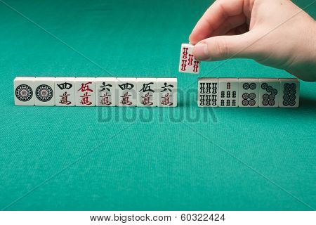 Smooth table surface with a mahjong on it