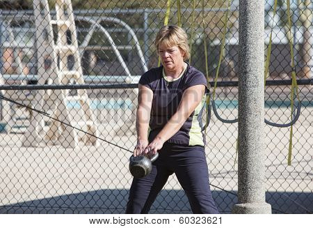 Middle Aged Woman Lifting Weights