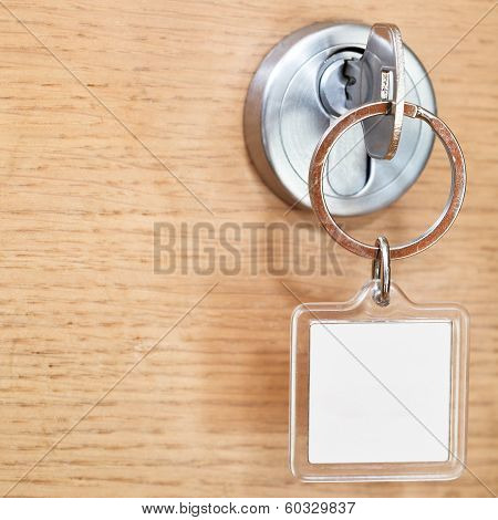 Key With Blank Square Keychain In Lock Close Up
