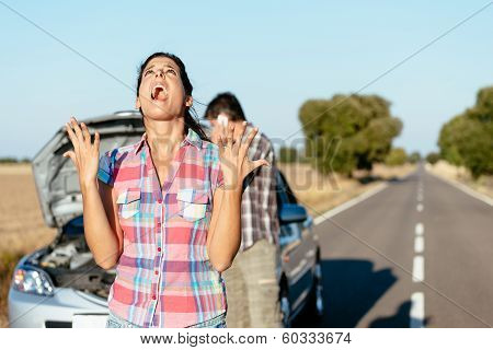 Desperate Woman Suffering Car Breakdown