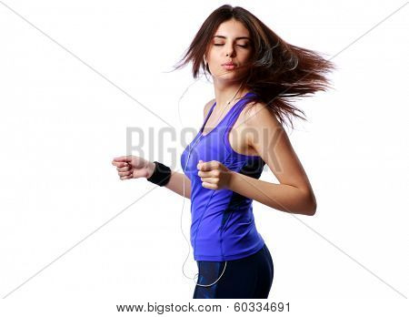 Young dancing sport woman listening to the music isolated on white background