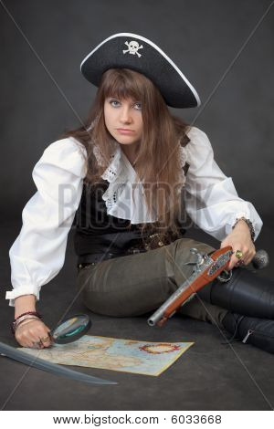 Woman In Costume Of Pirate With Sea Map And Magnifier Glass