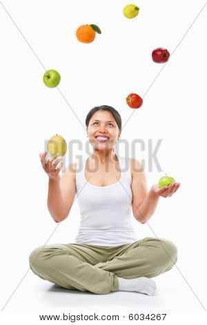 Asian Woman Juggling Fruits