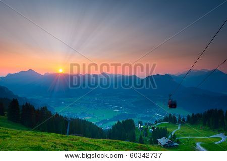sunbeams while sunrise in austrian mountains