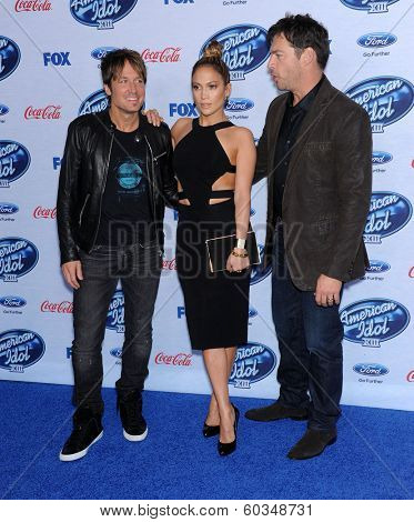 LOS ANGELES - FEB 20:  Keith Urban, Jennifer Lopez & Harry Connick Jr. arrives to the American Idol Top 13 Finalists  on February 20, 2014 in West Hollywood, CA