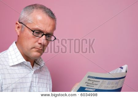Businessman Reading The Financial Newspaper