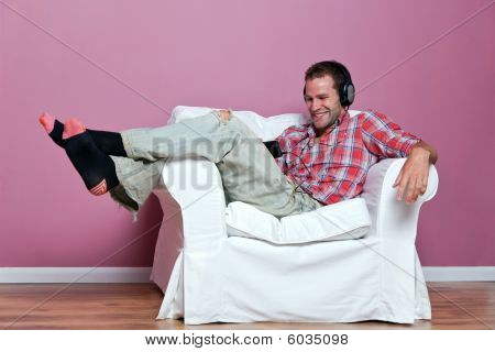Man Listening And Watching A Music Video