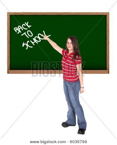 Woman Writing 'back To School' In A Chalkboard
