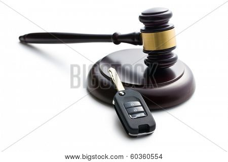 car key and judge gavel on white background