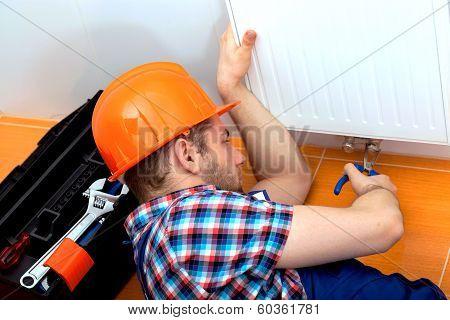 Handy Man Repairing Heater