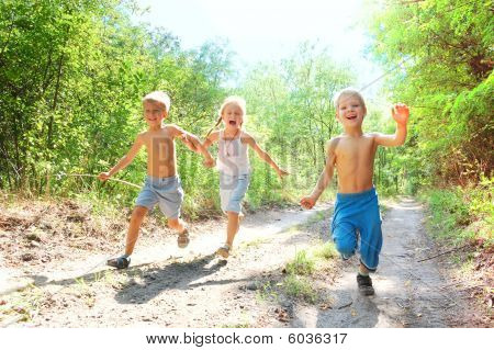Happy Kids Running In The Woods