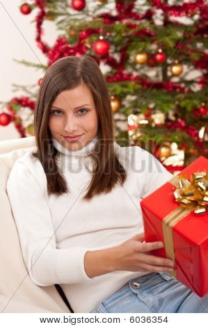 Young Woman Holding Christmas Present