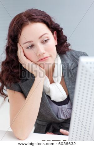 Young Businesswoman In Office Getting Bored