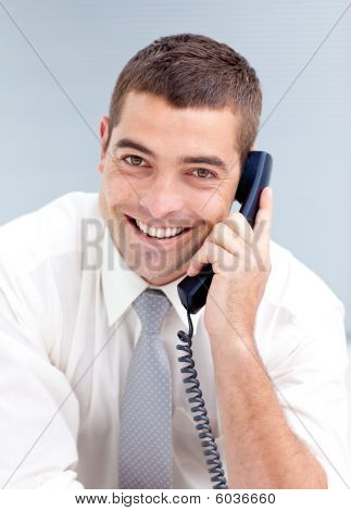 Attractive Businessman On Phone In Office