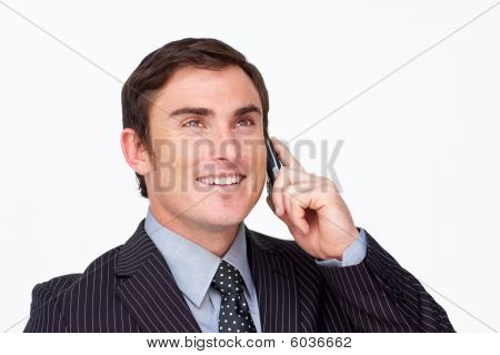 Portrait Of An Attractive Smioing Businessman On Mobile