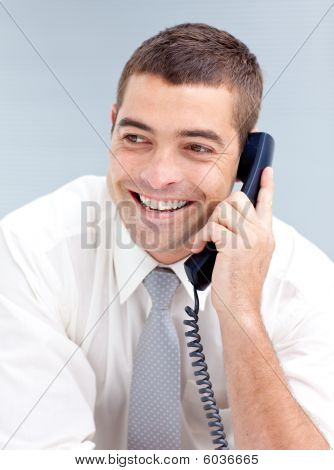 Smiling Businessman In Office Talking On Phone