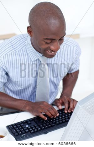 High Angle Of A Businessman Using A Computer In Office