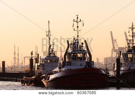 Two Tugboats Moored In A Harbour