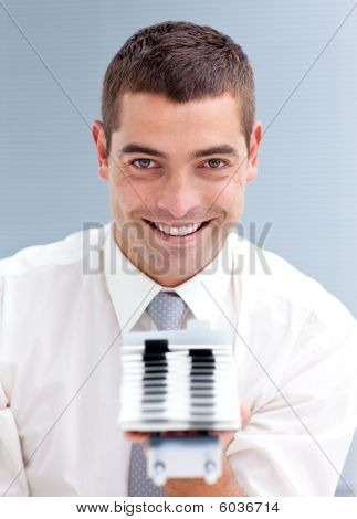 Attractive Businessman Consulting A Business-card Holder