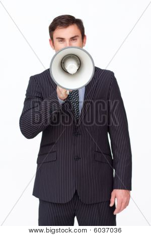 Handsome Businessman Shouting Through A Megaphone