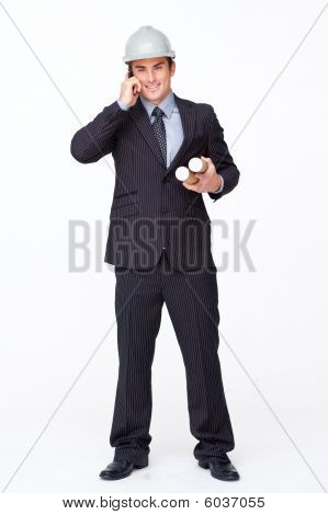 Smiling Attractive Architect On Phone Holding Plans