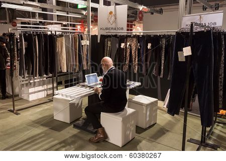 Exhibitor In His Stand At Mipap Trade Show In Milan, Italy