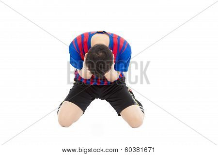 Agitated Soccer Player Kneel Down And  Cover His Face To Cry