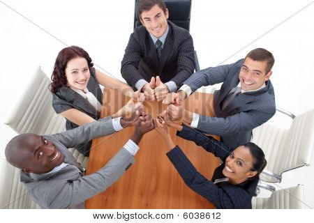 Happy Businesteam With Thumbs Up In Office