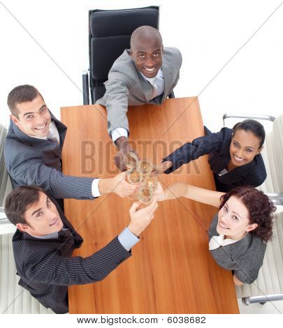 Business Team Toasting With Champagne In A Meeting