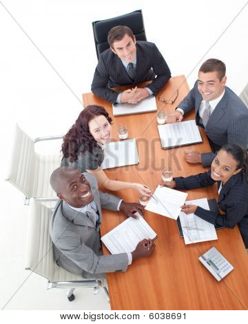 High Angle Of Happy Business People In A Meeting