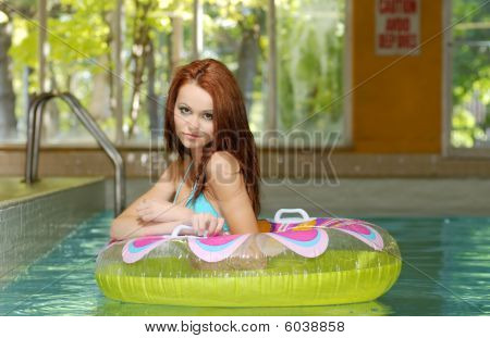 Brunette Woman In A Water Floating Tube