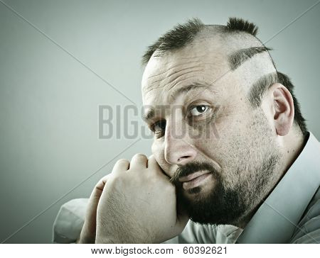 Man with funny silly half bald hair
