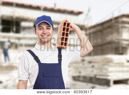 Portrait of a bricklayer at work